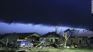 """As dawn breaks, storm clouds roll in over a destroyed neighborhood the day after a tornado hit in Moore, Oklahoma"" (EPA/ED ZURGA /LANDOV)"
