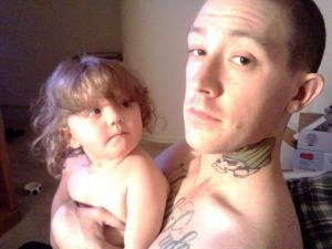 With his daughter, Ryley