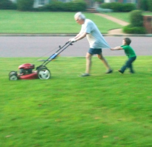 The #1 man in my life will always be the one in the green shirt helping the #2 man in my life mow the lawn.