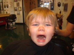 Adam's first haircut, shortly after his second birthday. Similar outbursts occurred today at school.