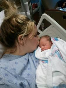 Tasha kisses newborn Ayden