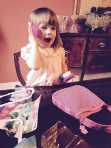 She's so happy with her new purse and phone!